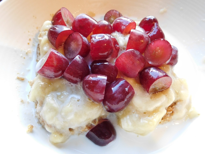 Weetabix with mashed banana and chopped grapes.