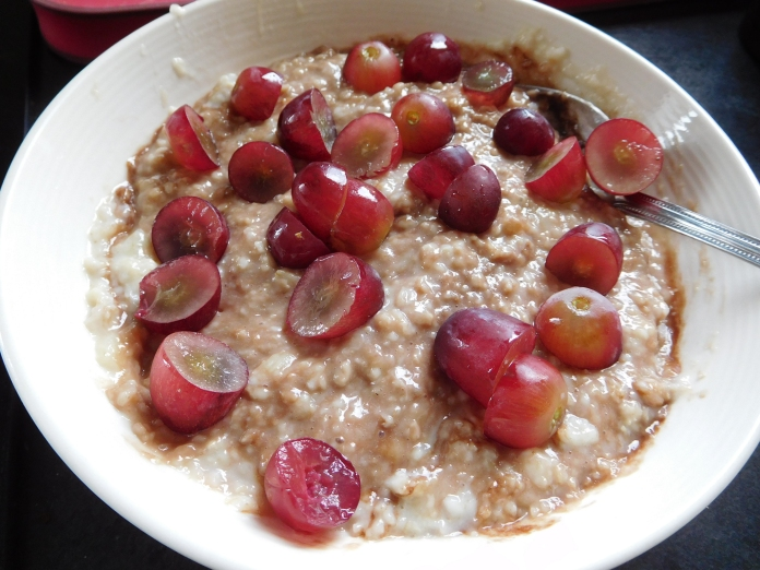 Quaker Oats Porridge with mashed banana and ChocShot in and chopped grapes on top